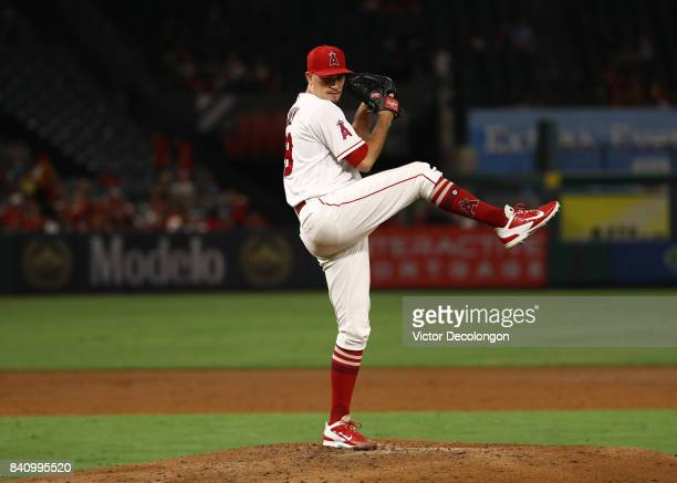 Pitcher Andrew Heaney of the Los Angeles Angels of Anaheim pitches during the third inning of the MLB game against the Oakland Athletics at Angel...