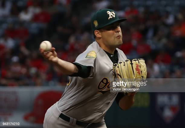 Pitcher Andrew Triggs of the Oakland Athletics pitches during the first inning of the MLB game at against the Los Angeles Angels of Anaheim at Angel...