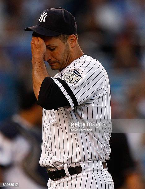 Pitcher Andy Pettitte of the New York Yankees walks off the mound after walking two batters in the first inning against the Boston Red Sox on August...