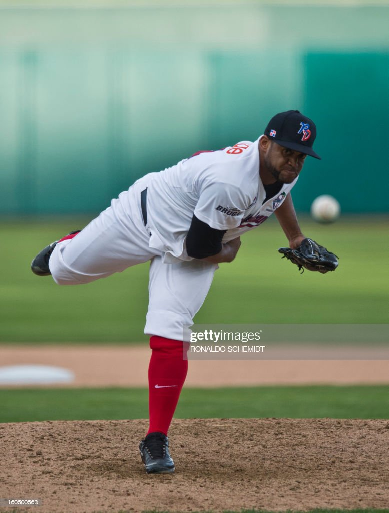 Pitcher Angel Castro of Leones del Escogido of Dominican Republic, pitches against Magallanes of Venezuela, in the Sonora Stadium, during the 2013 Baseball Caribbean Series, on February 1, 2013, in Hermosillo, Sonora State, northern Mexico. AFP PHOTO/Ronaldo Schemidt