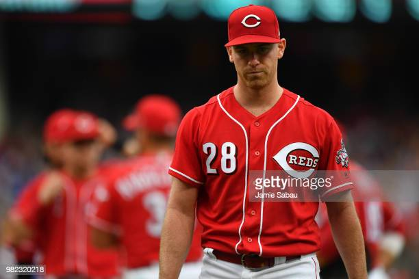 Pitcher Anthony DeSclafani of the Cincinnati Reds walks to the clubhouse after being replace in the seventh inning against the Chicago Cubs at Great...