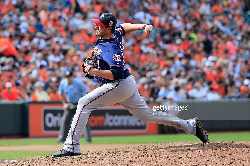 Pitcher Anthony Swarzak #51 of the Minnesota Twins throws to a Baltimore Orioles batter during the sixth inning at Oriole Park at Camden Yards on August 31, 2014 in Baltimore, Maryland.
