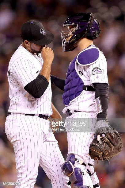 Pitcher Antonio Senzatela of the Colorado Rockies confers with catcher Tony Wolters in the ninth inning against the Chicago White Sox at Coors Field...