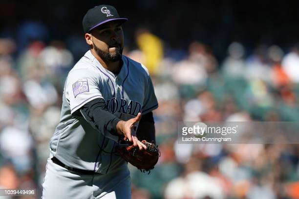 Pitcher Antonio Senzatela of the Colorado Rockies fields a ground ball hit by Dereck Rodriguez of the San Francisco Giants in the fifth inning at ATT...