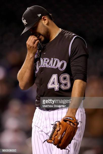 Pitcher Antonio Senzatela of the Colorado Rockies walks to the dugout in the seventh inning against the San Diego Padres at Coors Field on April 23...