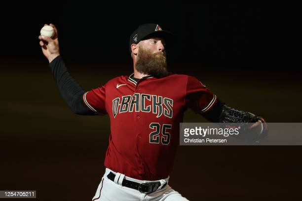 Pitcher Archie Bradley of the Arizona Diamondbacks throws a pitch during an intrasquad game ahead of the abbreviated MLB season at Chase Field on...