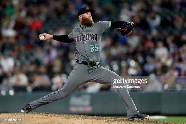 Pitcher Archie Bradley of the Arizona Diamondbacks throws in the eighth inning against the Colorado Rockies at Coors Field on May 03 2019 in Denver...