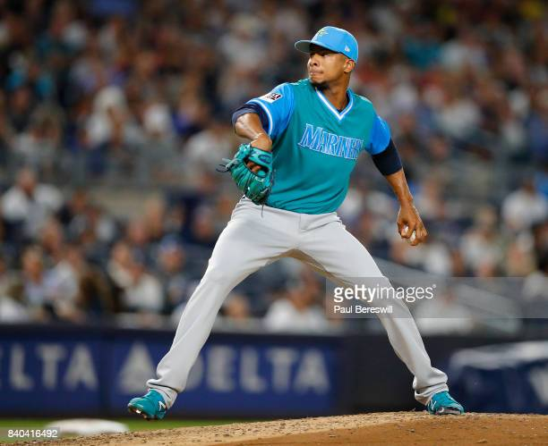 Pitcher Ariel Miranda of the Seattle Mariners pitches in an MLB baseball game against the New York Yankees on August 25 2017 at Yankee Stadium in the...