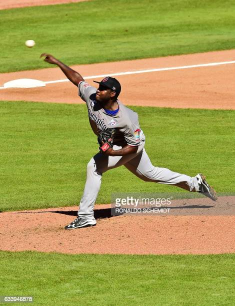 Pitcher Ariel Pena of Tigres del Licey from Dominican Republic throws against Aguilas del Zulia of Venezuela during the Caribbean Baseball Series at...