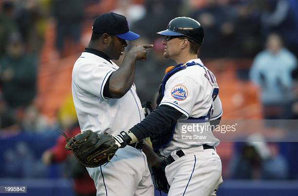 Pitcher Armando Benitez of the New York Mets congratulates teammate catcher Jason Phillips after the Mets beat the Montreal Expos 3-1 at Shea Stadium...