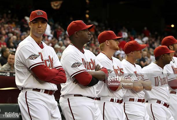 Pitcher Armando Galarraga of the Arizona Diamondbacks stands with teammates before the Major League Baseball home opening game against the Cincinnati...