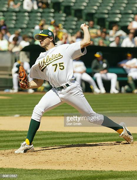 Pitcher Barry Zito of the Oakland Athletics pitches during the game against the Texas Rangers at the Network Associates Coliseum on April 7 2004 in...