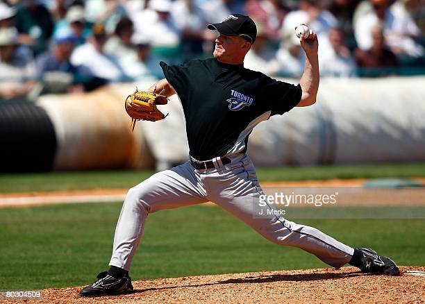 Pitcher BJ Ryan of the Toronto Blue Jays makes a pitch against the Pittsburgh Pirates during the Grapefruit League Spring Training game on March 17...