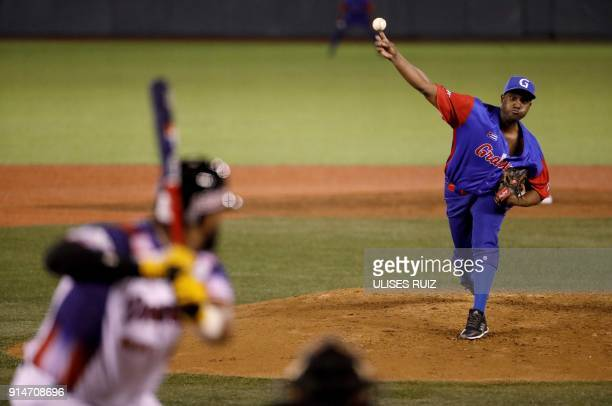 Pitcher Bladimir Banos of Alazanes del Granma of Cuba throws against Aguilas Cibaenas of Republica Dominicana during the Caribbean Baseball Series at...