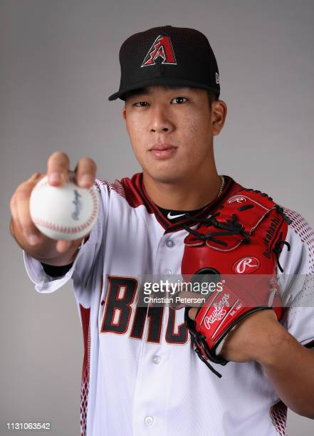 Pitcher Bo Takahashi of the Arizona Diamondbacks poses for a portrait during photo day at Salt River Fields at Talking Stick on February 20 2019 in...