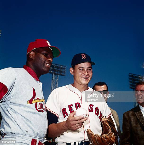 Pitcher Bob Gibson of St Louis Cardinals is seen here with Red Sox Pitcher Jose Santiago at Fenway Park on October 3rd a day before the World Series...