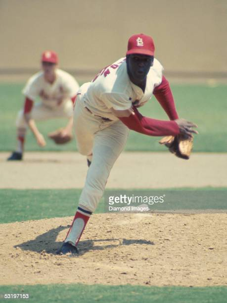 Pitcher Bob Gibson of the St Louis Cardinals follows through on a pitch during Game 1 of the World Series on October 2 1968 against the Detroit...