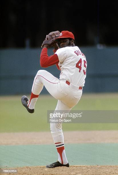 Pitcher Bob Gibson of the St Louis Cardinals pitches during a circa early 1970s Major League Baseball game at Busch Stadium in St Louis Missouri...