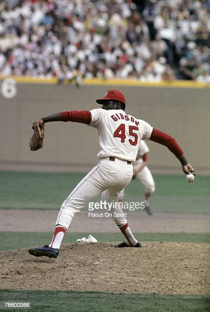 1960s: Pitcher Bob Gibson of the St. Louis Cardinals pitches during a circa late 1960s Major League Baseball game at Busch Stadium in St. Louis,...