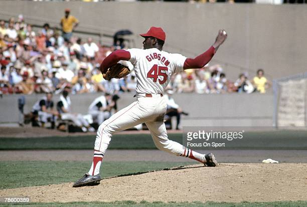 Pitcher Bob Gibson of the St Louis Cardinals pitches during a circa late 1960s Major League Baseball game at Busch Stadium in St Louis Missouri...