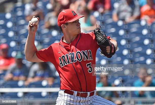 Pitcher Bobby Dalbec of the Arizona Wildcats delivers a pitch against the Coastal Carolina Chanticleers in the first inning during game three of the...