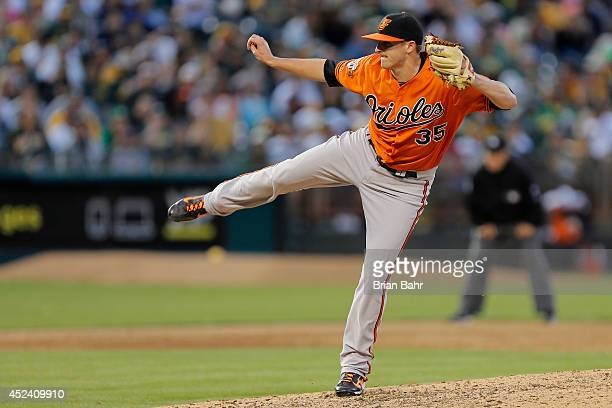 Pitcher Brad Brach of the Baltimore Orioles follows through on a throw against the Oakland A's at Oco Coliseum on July 19 2014 in Oakland California...