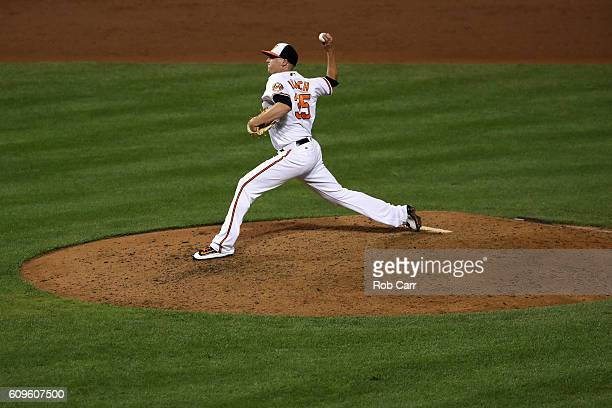 Pitcher Brad Brach of the Baltimore Orioles throws to a Boston Red Sox batter in the sixth inning at Oriole Park at Camden Yards on September 21 2016...
