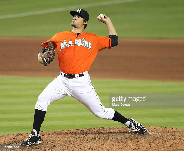 Pitcher Brad Hand of the Miami Marlins throws in the 10th inning against the New York Mets at Marlins Park on May 1 2013 in Miami Florida