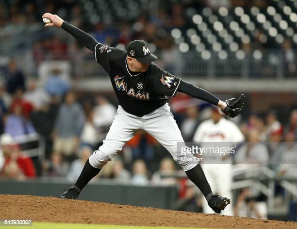 Pitcher Brad Ziegler of the Miami Marlins throws a pitch in the ninth inning during the game against the Atlanta Braves at SunTrust Park on September...