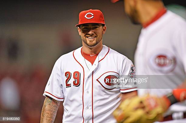 Pitcher Brandon Finnegan of the Cincinnati Reds walks off the field with a smile after the fifth inning against the Philadelphia Phillies at Great...