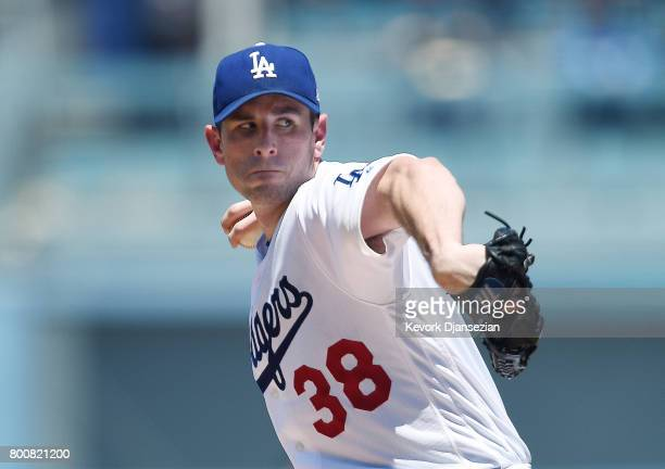 Pitcher Brandon McCarthy of the Los Angeles Dodgers throws a pitch against the Colorado Rockies during the third inning of the baseball game at...