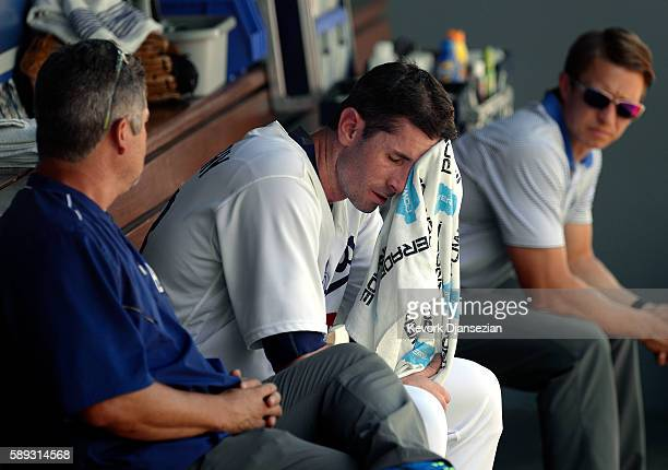 Pitcher Brandon McCarthy of the Los Angeles Dodgers wipes his face as he reacts after coming out of the baseball game with an injury during the...