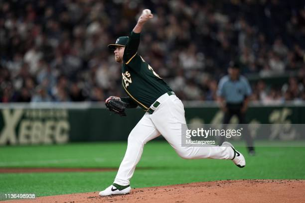 Pitcher Brett Anderson of the Oakland Athletics throws in the bottom of 1st inning during the preseason friendly game between Hokkaido NipponHam...