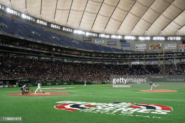 Pitcher Brett Anderson of the Oakland Athletics throws in the bottom of third inning during the preseason friendly game between Hokkaido NipponHam...