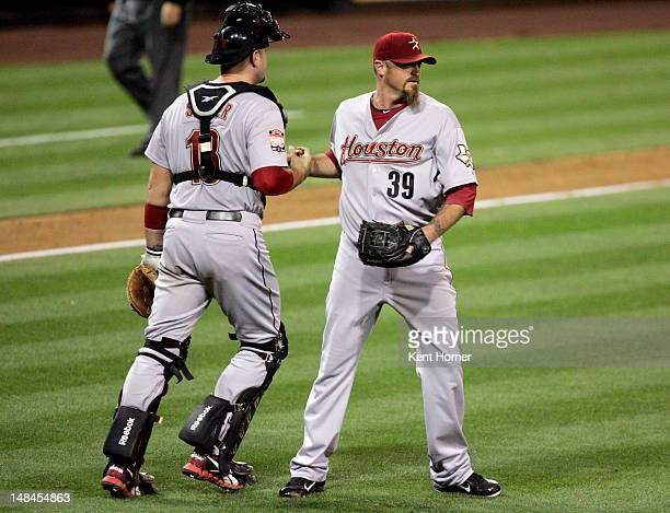 SAN DIEGO CA Pitcher Brett Myers of the Houston Astros is congratulated by catcher Chris Snyder recording the save by winning the game against the...