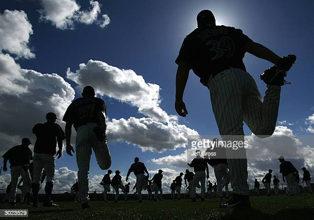 Pitcher Brian Bruney of the Arizona Diamondbacks and his teammates stretch during Media Day on February 28 2004 at Tucson Electric Park in Tucson...