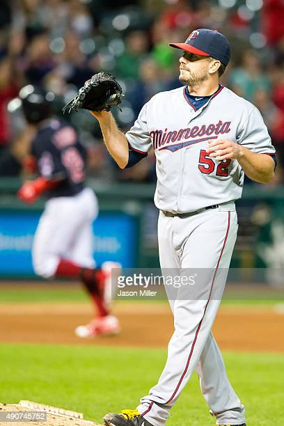 Pitcher Brian Duensing of the Minnesota Twins receives a new ball after Francisco Lindor of the Cleveland Indians hit a tworun home run in the fourth...