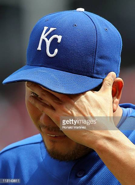 Pitcher Bruce Chen of the Kansas City Royals wipes his face as he is relieved against the Texas Rangers in the 6th inning at Rangers Ballpark in...