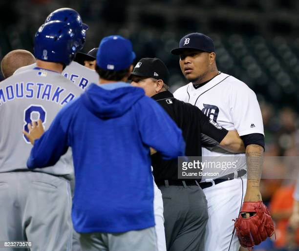 Pitcher Bruce Rondon of the Detroit Tigers and Mike Moustakas of the Kansas City Royals stare down each other after Moustakas was hit by a pitch from...