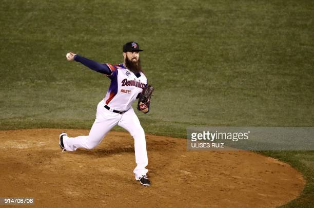 Pitcher Bryan Evans of Aguilas Cibaenas of Republica Dominicana throws against Alazanes del Granma of Cuba during the Caribbean Baseball Series at...
