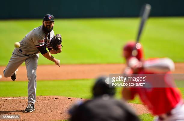 Pitcher Bryan Evans of Tigres del Licey from Dominican Republic throws against Criollos de Caguas during the Caribbean Baseball Series at the...