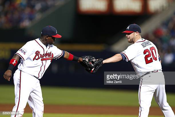 Pitcher Bud Norris of the Atlanta Braves congratulates third baseman Adonis Garcia after Garcia's diving play in the fifth inning during the game...