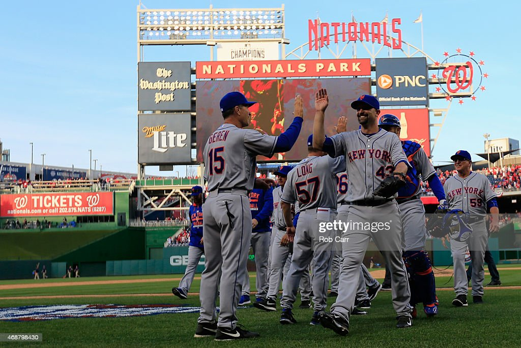 Pitcher Buddy Carlyle #43 of the New York Mets celebrates the Mets 3-1 opening day win over the Washington Nationals with bench coach Bob Geren #15 at Nationals Park on April 6, 2015 in Washington, DC.
