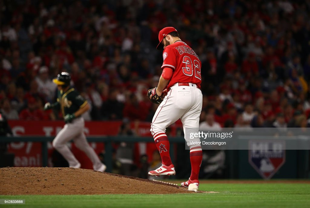 Pitcher Cam Bedrosian #32 of the Los Angeles Angels of Anhaeim looks down at the mound in the fifth inning after giving up a two-run homerun to Matt Chapman #26 of the Oakland Athletics during the fifth inning of their MLB game at Angel Stadium on April 6, 2018 in Anaheim, California.