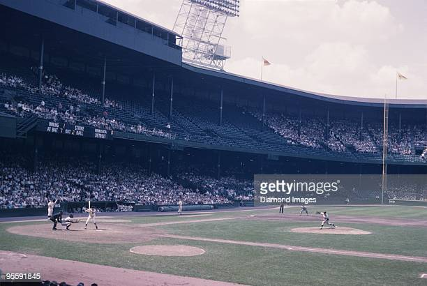 Pitcher Camilo Pascual of the Washington Senators throws a pitch to outfielder Rocky Colavita of the Detroit Tigers during a game on August 21 1963...