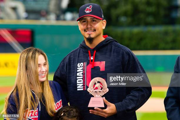 Pitcher Carlos Carrasco of the Cleveland Indians receives the Roberto Clemente award prior to the game against the Baltimore Orioles at Progressive...