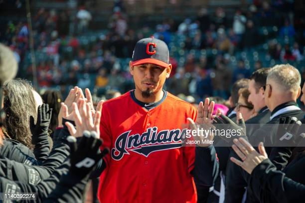 Pitcher Carlos Carrasco of the Cleveland Indians runs onto the field during the player introduction during the game against the Chicago White Sox at...