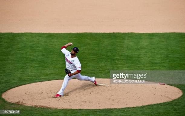 Pitcher Carlos Pimentel of Leones del Escogido of Dominican Republic pitches against Criollos de Caguas of Puerto Rico during the 2013 Caribbean...