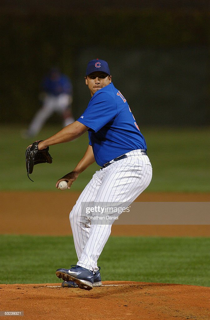 Pitcher Carlos Zambrano #38 of the Chicago Cubs delivers a pitch against  the Cincinnati Reds