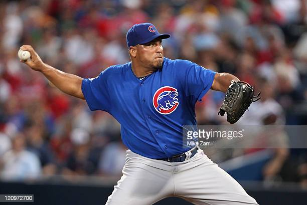 Pitcher Carlos Zambrano of the Chicago Cubs throws a pitch during the game against the Atlanta Braves at Turner Field on August 12 2011 in Atlanta...